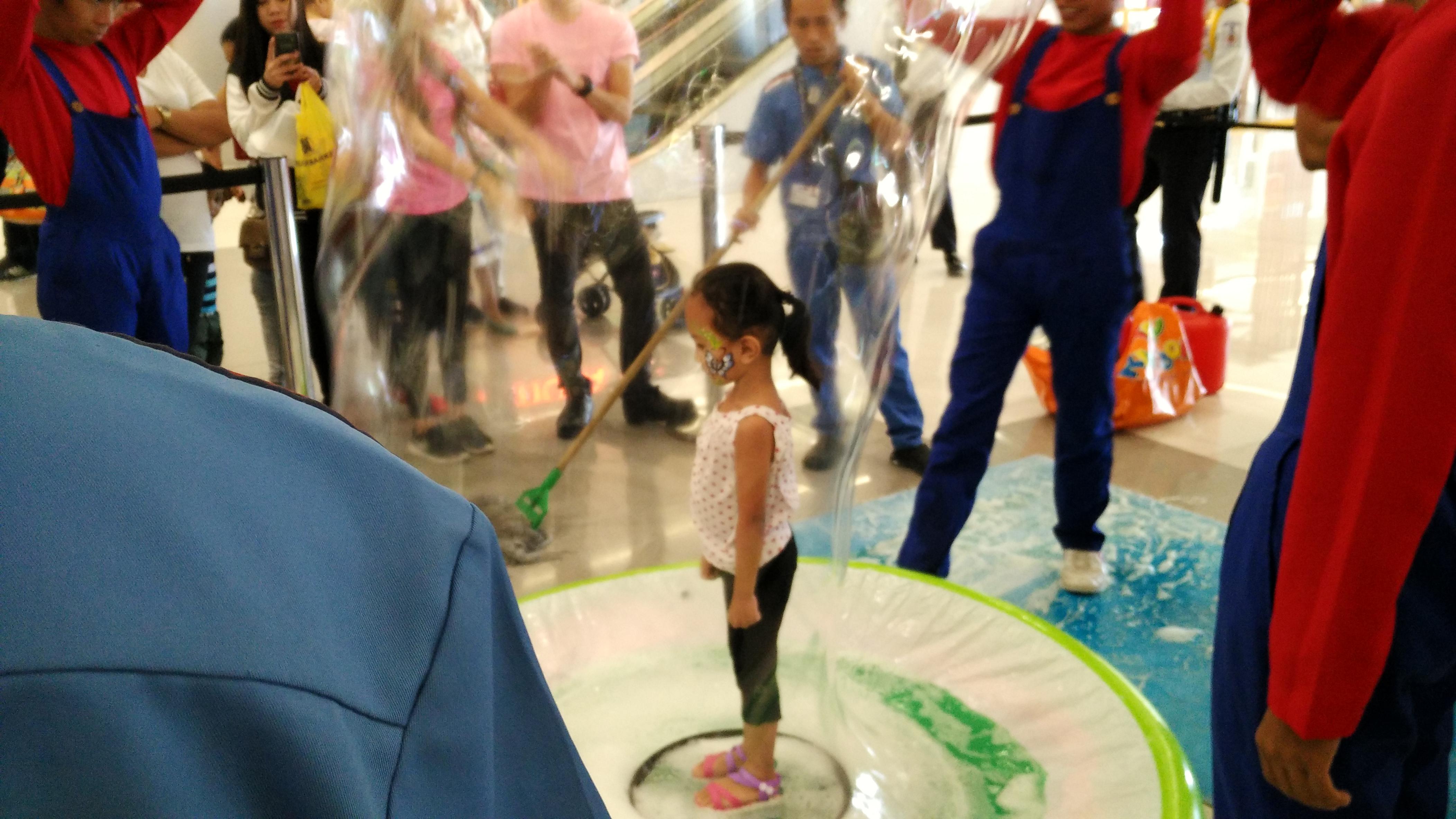 Kids inside giant bubbles