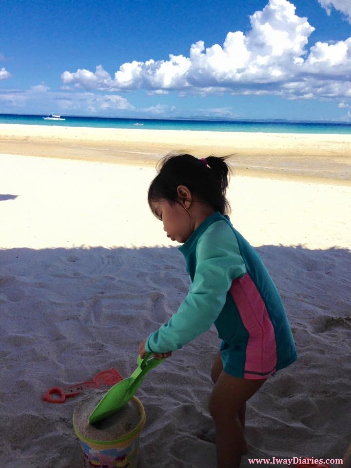 kid playing with sand - bantayan cebu