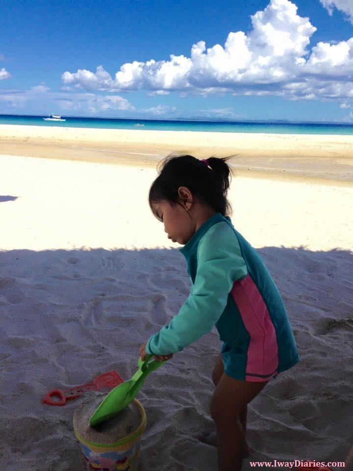 kid playing with sand - bantayan cebu