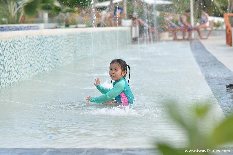 Kid enjoying pool water