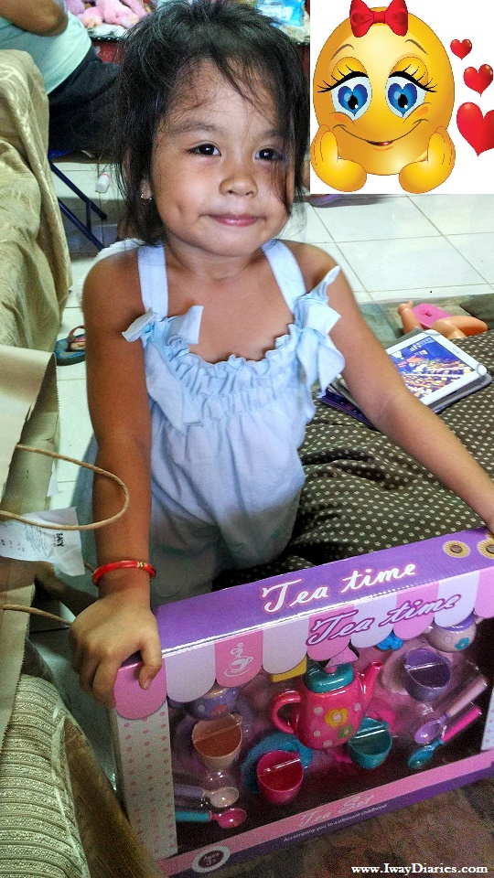 Happy kid for her new tea set