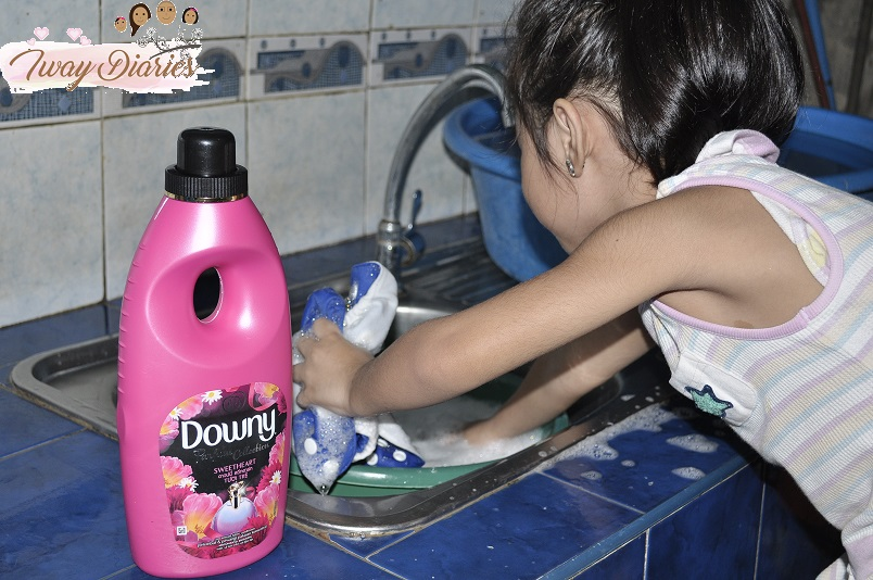 Louise washing clothes