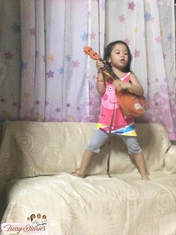kid playing music